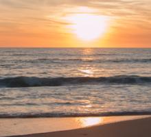 Sunset by the beach  Sticker