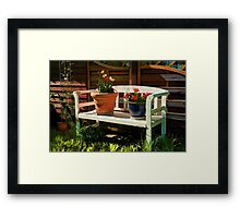 Garden bench with flowers Framed Print