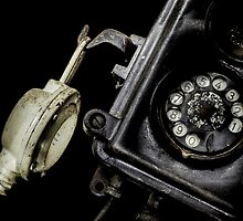 Close-up of an old black telephone by enolabrain