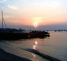 Sunset at fairview beach Virginia on the Potomac river by windrider