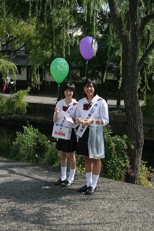 Kurashiki school girls raising funds for Red Feather appeal.   by Trishy