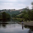Girl wading in Rydal river at Rydal waters Lake District England 198405200041 by Fred Mitchell