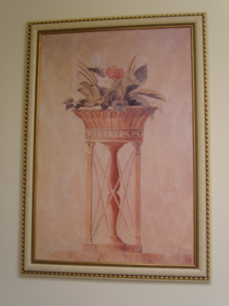 Flowers in a tall pot by jpturf