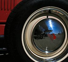 Hubcap with Airplane Reflection by whircat