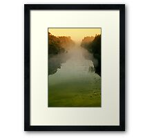 Sunrise in morning mist Framed Print