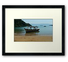 footsteps on an untouched beach Framed Print