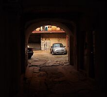 Small car in a small yard in Vilnius Oldtown. by miniailov