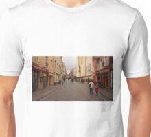 Summer wearing guy goes between people dressed wintry. Unisex T-Shirt