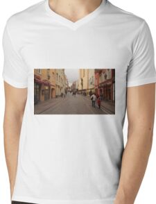 Summer wearing guy goes between people dressed wintry. Mens V-Neck T-Shirt