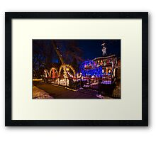 Crazy amount of xmas lights on this house Framed Print