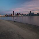 Lone fisherman at dawn with Chicago Skyline by Sven Brogren