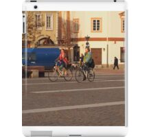 Couple running on bicycles in OldTown. iPad Case/Skin