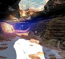 Underwater cave sunlight shines by Aurora