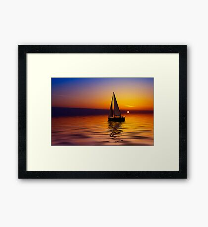 Sailboat against a beautiful sunset Framed Print