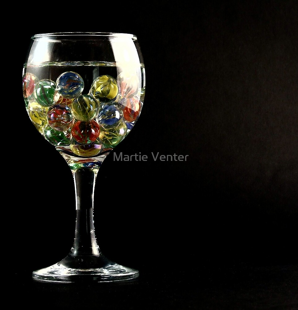 Marbles in Wineglass by Martie Venter