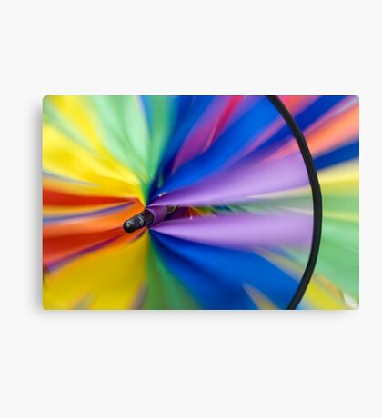 Wind Vane - A spiral wind vane made of colorful strips of cloth and sprockets Canvas Print