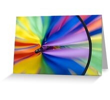 Wind Vane - A spiral wind vane made of colorful strips of cloth and sprockets Greeting Card