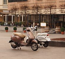 A couple of parked scooters. by miniailov