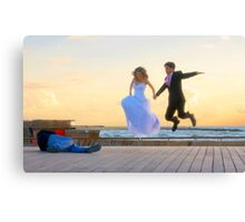 Jump of joy! A couple about to get married, is photographed at the Tel Aviv Marina, Israel Canvas Print