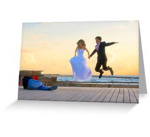 Jump of joy! A couple about to get married, is photographed at the Tel Aviv Marina, Israel Greeting Card