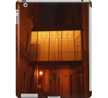 A tunnel between buildings at night. iPad Case/Skin