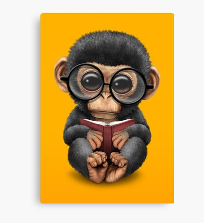 Cute Baby Chimpanzee Reading a Book on Yellow Canvas Print