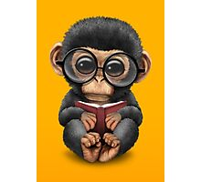 Cute Baby Chimpanzee Reading a Book on Yellow Photographic Print