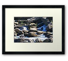 Water cutting through rock Framed Print