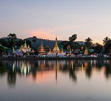 Reflection of Wat Chong Kham at dusk by Guy  Berresford