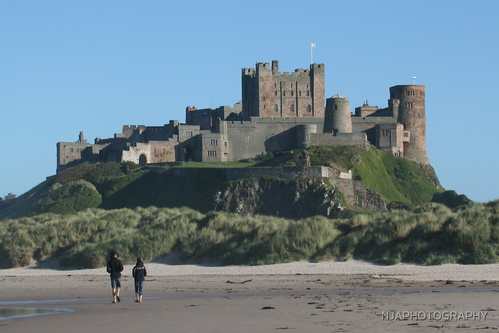 view across the sand to bamburgh castle by NJAPHOTOGRAPHY