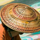 Artist's Hat-An artist is working on a chalk painting at the Imadinari Street Painting Festival.  Santa Barbara, California by Eyal Nahmias