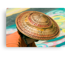 Artist's Hat-An artist is working on a chalk painting at the Imadinari Street Painting Festival.  Santa Barbara, California Canvas Print