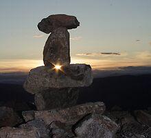 Midnight-Sun Through Inukshuk by Crokuslabel