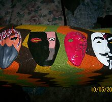 Four Masks by Robert Muggli