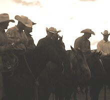 Silhouetted cowboys by courier