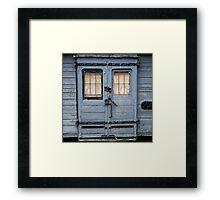 Weatherd train Door Framed Print