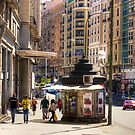 Newspaper Stand on the Gran Via by Tom Gomez
