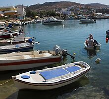 Greek Islands - locals set off fishing by Ryan Jennings
