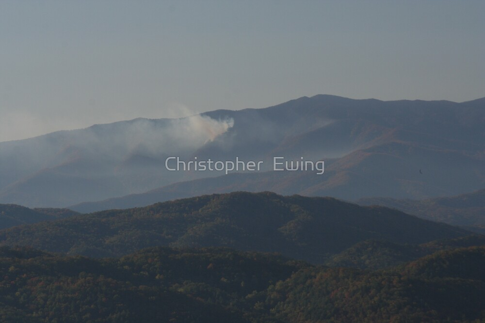 fire over the mountains by Christopher  Ewing