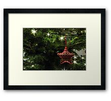 Knitted star Framed Print