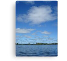 Clouds above the water Canvas Print