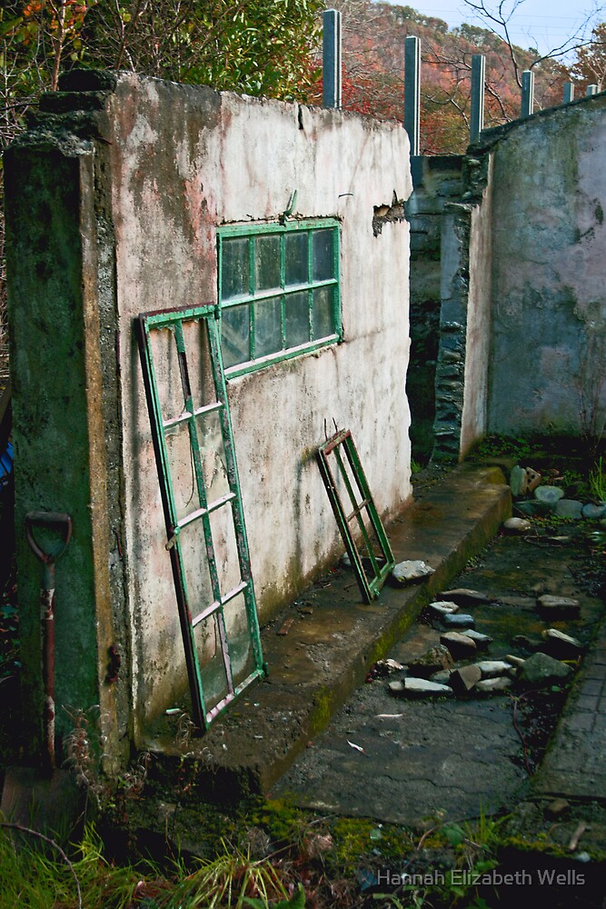Broken window and an old wall by Hannah Elizabeth Wells