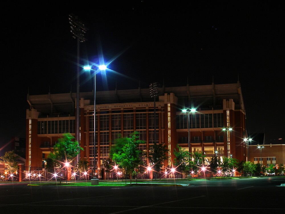 Oklahoma memorial stadium at night by mbuban