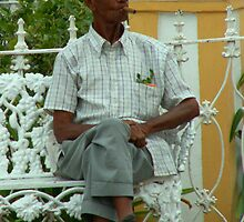 cuban man on bench by ashley reed