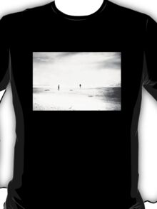 Man and woman are walking on the beach T-Shirt