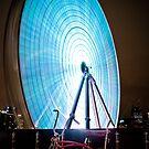 Little Red Pushbike meets Big Blue Ferris Wheel by David Johnson