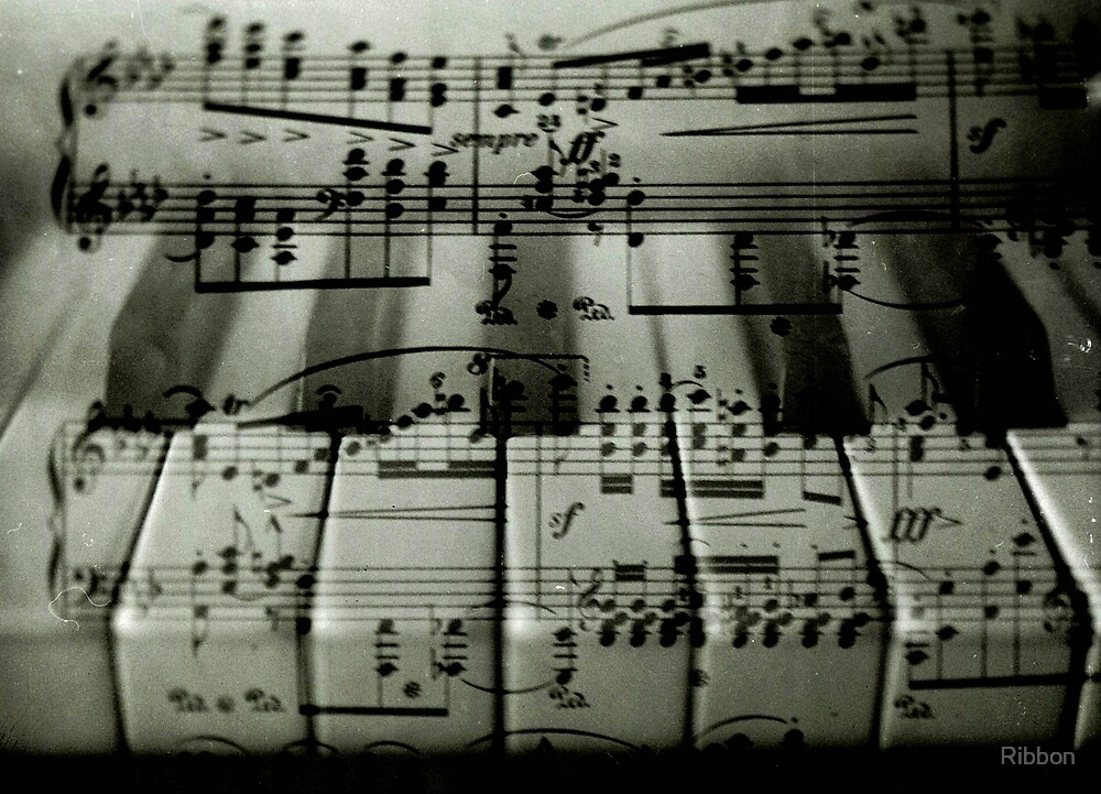 Piano keys with music by Ribbon