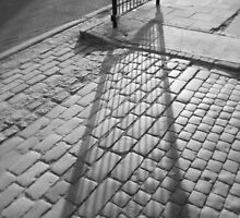 Shadow on Cobbles  by Karen Martin