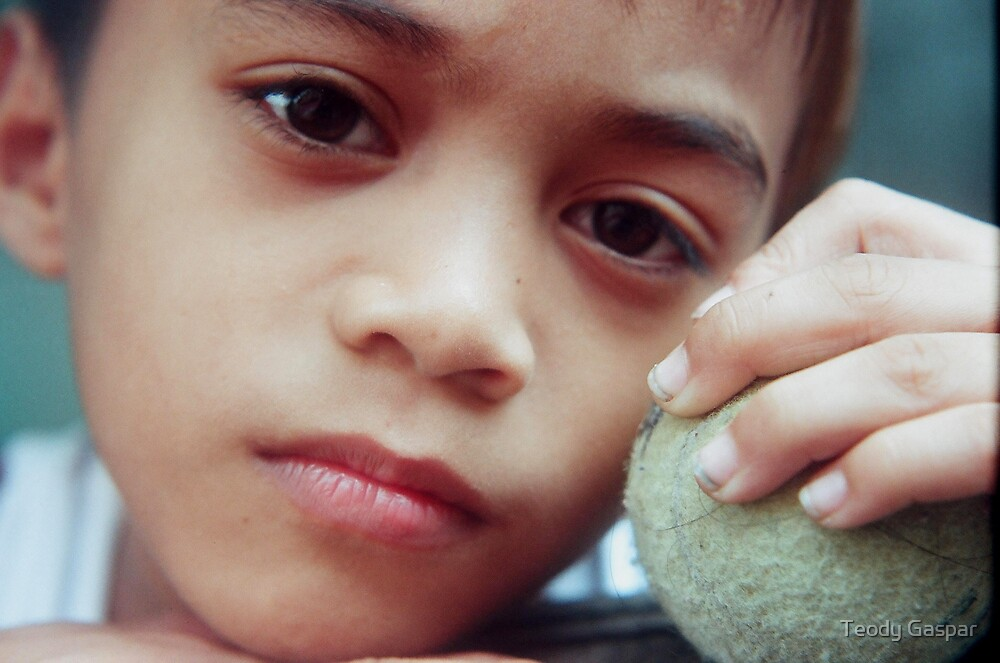 Boy Holding An Old Tennis Ball by Teody Gaspar
