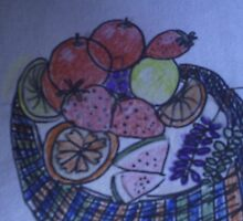 A tasty basket of fruit by candle
